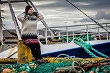 Woman and fishing ship