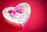 gift box with ribbon on red background,concept of valentine day