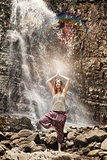 Yoga exercise on the waterfall background