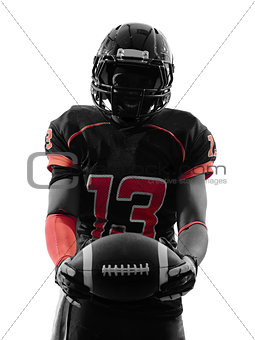 american football player standing holding ball silhouette