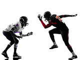two american football players on scrimmage silhouette