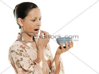 Portrait of beautiful Asian woman taking pill