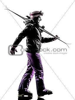 one woman skier  walking silhouette