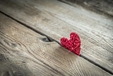Handmade retro heart on the wooden background