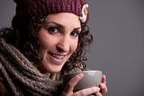 smiling woman with a mugful of a hot drink