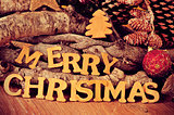 wooden letters forming the sentence merry christmas
