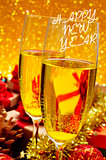 glasses with champagne and the sentence happy new year