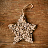 rustic christmas star on a wooden surface