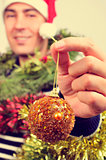 young man covered with christmas ornaments