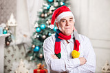 Senior man in Santa's hat on Christmas background