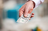 Hand with money against blurred background