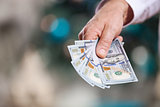 Hand with money on a blurred background
