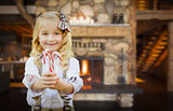 Cute Young Girl Holding Candy Canes in Rustic Cabin
