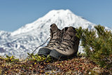 Trekking boots on background volcano