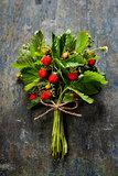fresh Wild strawberries on wooden background