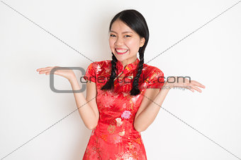 Asian chinese girl showing palm