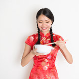 Asian chinese girl eating something
