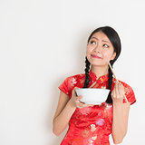 Asian chinese girl eating and thinking