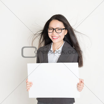 Asian business woman holding a blank placard