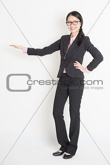 Asian business woman showing copy space
