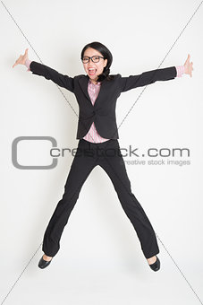 Business woman leaping high in the air