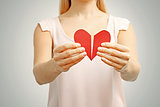 broken red heart in woman hands. concept of relationship, divorc