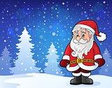 Santa Claus standing in snow
