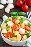 Pasta with mozzarella and tomato