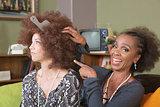 Woman Making Fun of Friend's Hair