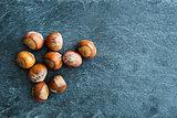 Closeup on hazelnuts on stone substrate