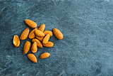 Closeup on almonds on stone substrate