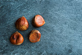 Closeup on chestnuts on stone substrate