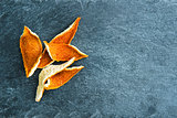 Closeup on dried orange peels on stone substrate