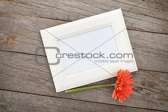 Blank photo frame and orange gerbera