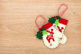 Christmas mitten decor on wooden background