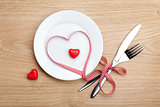 Valentine's Day heart shaped red ribbon over plate