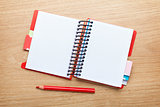 Office table with blank notepad and red pencil
