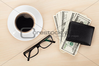 Money cash, glasses and coffee cup