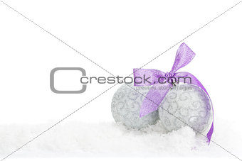 Christmas baubles and purple ribbon