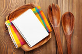 Wood kitchen utensils over wooden table background