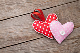 Valentines day toy hearts over wooden table background
