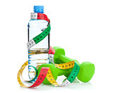 Two green dumbells, tape measure and water bottle