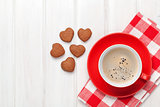 Valentines day heart shaped cookies and red coffee cup