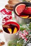 Christmas mulled wine on wooden table with fir tree