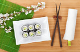 Sushi maki set and sakura branch