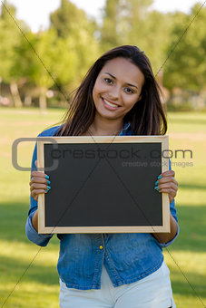 Beautiful woman holding a shalkboard
