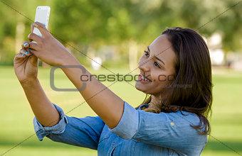 Beautiful woman taking a photo