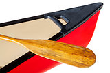 red canoe with paddle