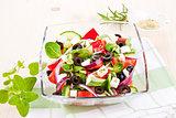 Fresh salad with fresh herbs.