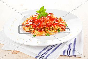 Tortellini with tomato sauce.